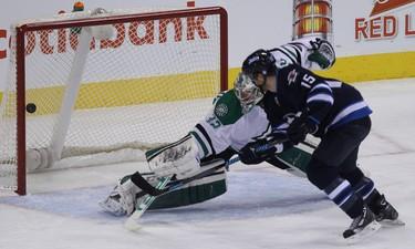 Winnipeg Jets forward Matt Halischuk scores past Dallas Stars goaltender Kari Lehtonen during first-period NHL action at MTS Centre in Winnipeg, Man. on Sat., Dec. 14, 2013. Kevin King/Winnipeg Sun/QMI Agency