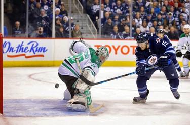 Winnipeg Jets forward Matt Halischuk (15) scores on Dallas Stars goalie Kari Lehtonen (32) during the first period at MTS Centre. (Bruce Fedyck/USA TODAY)