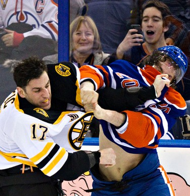 Edmonton's Luke Gazdic (20) fights Boston's Milan Lucic (17) during the second period of the Edmonton Oilers' NHL hockey game against the Boston Bruins at Rexall Place in Edmonton, Alta., on Thursday, Dec. 12, 2013. Codie McLachlan/Edmonton Sun/QMI Agency