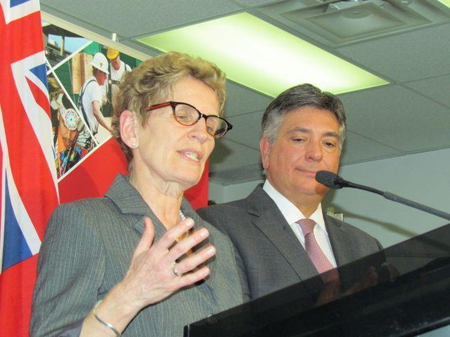 Ontario Premier Kathleen Wynne with Finance Minister Charles Sousa. (Toronto Sun files)