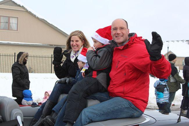 Councillor Matt Brown rides with his family during the Hyde Park Santa Clause parade on Nov. 30