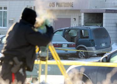 Winnipeg Police investigate following an overnight shooting outside 445 Partridge Avenue in Winnipeg, Man. Monday December 23, 2013. Brian Donogh/Winnipeg Sun/QMI Agency