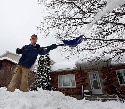 Daniel Julien-Neitzert tries to shorten a snow bank outside his home in Ottawa on Monday December 23, 2013. Darren Brown/Ottawa Sun/QMI Agency