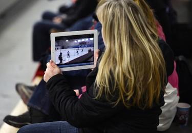 A fan films a game during the Bell Capital Cup Tournament at the Bell Sensplex in Ottawa on Sunday, Dec. 29, 2013. (Matthew Usherwood/ Ottawa Sun)