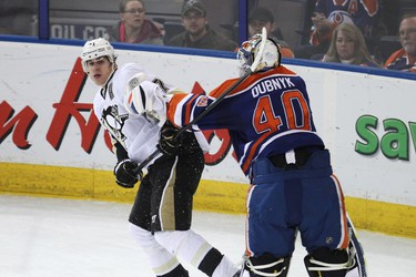 Edmonton goaltender Devan Dubnyk (40) and Pittsburgh forward Evgeni Malkin (71) fight during the second period of a NHL game as the Edmonton Oilers play the Pittsburgh Penguins at Rexall Place in Edmonton, Alta., on Friday, Jan. 10, 2014. Ian Kucerak/Edmonton Sun/QMI Agency