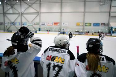 Atom B Warriors players watch their team play the Spruce Grove Snipers during Quikcard Edmonton Minor Hockey Week 2014 play at Terwillegar Community Rec Centre in Edmonton, Alta., on Saturday, Jan. 18, 2014. Minor Hockey Week runs through Jan. 19, 2014. Ian Kucerak/Edmonton Sun/QMI Agency