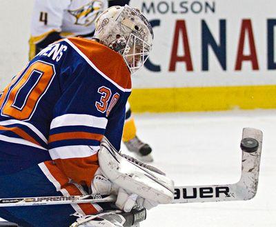 Edmonton's goalie Ben Scrivens (30) makes a save during the first period of the Edmonton Oilers' NHL hockey game against the Nashville Predators at Rexall Place in Edmonton, Alta., on Sunday, Jan. 26, 2014. Codie McLachlan/Edmonton Sun/QMI Agency