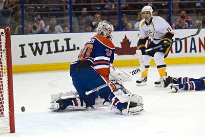 Edmonton's goalie Ben Scrivens (30) can't stop Nashville's David Legwand (11) from scoring during the first period of the Edmonton Oilers' NHL hockey game against the Nashville Predators at Rexall Place in Edmonton, Alta., on Sunday, Jan. 26, 2014. Codie McLachlan/Edmonton Sun/QMI Agency