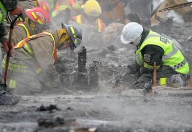 Emergency workers sort through the debris at Résidence du Havre in L'Isle-Verte on Tuesday Jan. 28, 2014. Annie T Roussel/QMI Agency