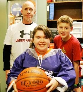 Wheelchair basketball guru Sydnee Satermo is flanked by teacher Cam Laevens and fellow student Parker Eklund. - Gord Montgomery, Reporter/Examiner