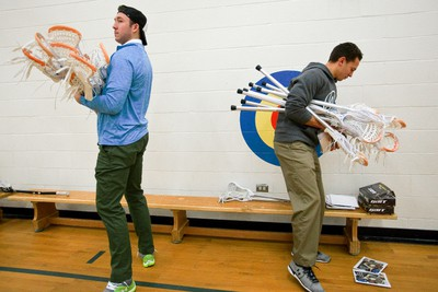 Edmonton Rush players Mark Matthews (left) and Jarrett Davis carry brand new lacrosse sticks to be given to school children at Ormsby Elementary School in Edmonton, Alta., on Friday, Jan. 31, 2014. Twenty kids received lacrosse sticks during the visit. Ian Kucerak/Edmonton Sun/QMI Agency
