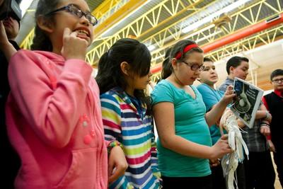 School children at Ormsby Elementary School in Edmonton, Alta., receive brand new lacrosse sticks from Edmonton Rush lacrosse players on Friday, Jan. 31, 2014. Twenty kids received lacrosse sticks. Ian Kucerak/Edmonton Sun/QMI Agency