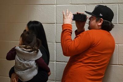 Parents of school children at Ormsby Elementary School listen to a video in Edmonton, Alta., as they met Edmonton Rush lacrosse players on Friday, Jan. 31, 2014. Twenty kids received lacrosse sticks. Ian Kucerak/Edmonton Sun/QMI Agency
