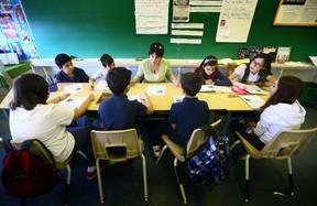 Grade 6 students read in class at Stella Maris Separate School in Toronto. (Dave Abel/Toronto Sun)