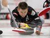 Skip Mike McEwen delivers a rock during the Safeway Select men's curling final in Winnipeg, Man. Sunday February 02, 2014. Brian Donogh/Winnipeg Sun/QMI Agency