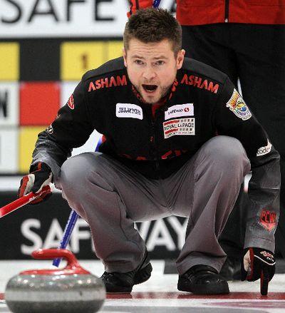 Skip Mike McEwen calls in a rock during the Safeway Select men's curling final in Winnipeg, Man. Sunday February 02, 2014. Brian Donogh/Winnipeg Sun/QMI Agency