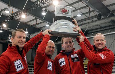 (L-R) Skip Jeff Stoughton, Jon Mead, Reid Carruthers and Mark Nichols hoist the trophy after defeating Mike McEwen 8-3 in the Safeway Select men's curling final in Winnipeg, Man. Sunday February 02, 2014. Brian Donogh/Winnipeg Sun/QMI Agency