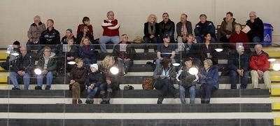 A small group of fans watches the Safeway Select men's curling final in Winnipeg, Man. Sunday February 02, 2014. Brian Donogh/Winnipeg Sun/QMI Agency