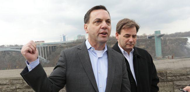 Ontario Progressive Conservative Leader Tim Hudak speaks to reporters about job losses in Niagara as Niagara Falls PC candidate Bart Maves listens. Mike DiBattista/QMI Agency)