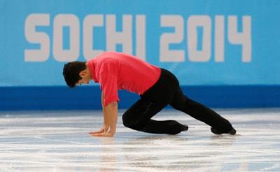 Canada's Liam Firus falls during the figure skating men's short program at the Sochi 2014 Winter Olympics, February 13, 2014. REUTERS/Alexander Demianchuk