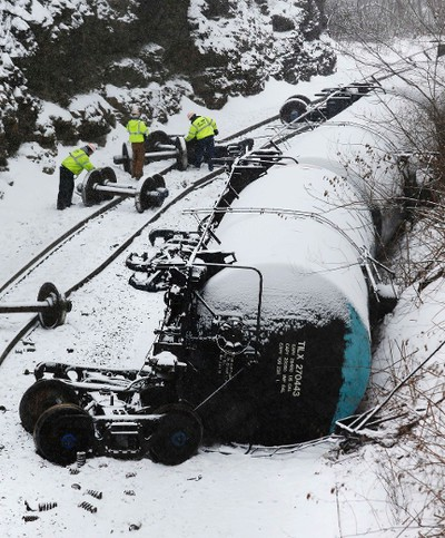 Emergency personnel examine the wreckage of a train derailment near Vandergrift, Pennsylvania February 13, 2014. REUTERS/Jason Cohn