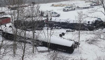 The wreckage of a train derailment is seen in the snow near Vandergrift, Pennsylvania February 13, 2014.  REUTERS/Jason Cohn