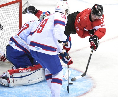 Canada's Jamie Benn goes flying during an Olympic men's hockey game against Norway on Feb. 12. (Ben Pelosse, QMI Agency)