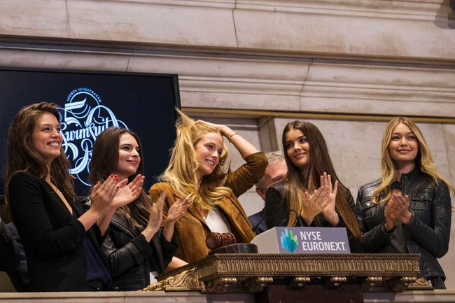 Sports Illustrated Swimsuit Models Emily DiDonato, Natasha Barnard, Kate Bock, Emily Ratajkowski and Gigi Hadid (L-R) ring the closing bell at the New York Stock Exchange on Thursday, Feb. 13, 2014. (Brendan McDermid/Reuters)