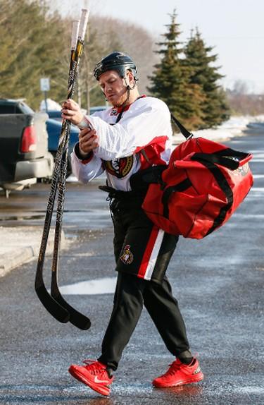 Ottawa Senator Chris Neil makes his way into the Sensplex for team practice on Wednesday February 19,2014. Errol McGihon/Ottawa Sun/QMI Agency