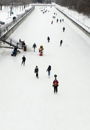 The Ottawa Senators Cody Ceci skates the the Google Street View Trekker along the final kilometre of the Rideau Canal Skateway in Ottawa on Thursday February 20, 2014.Darren Brown/Ottawa Sun/QMI Agency