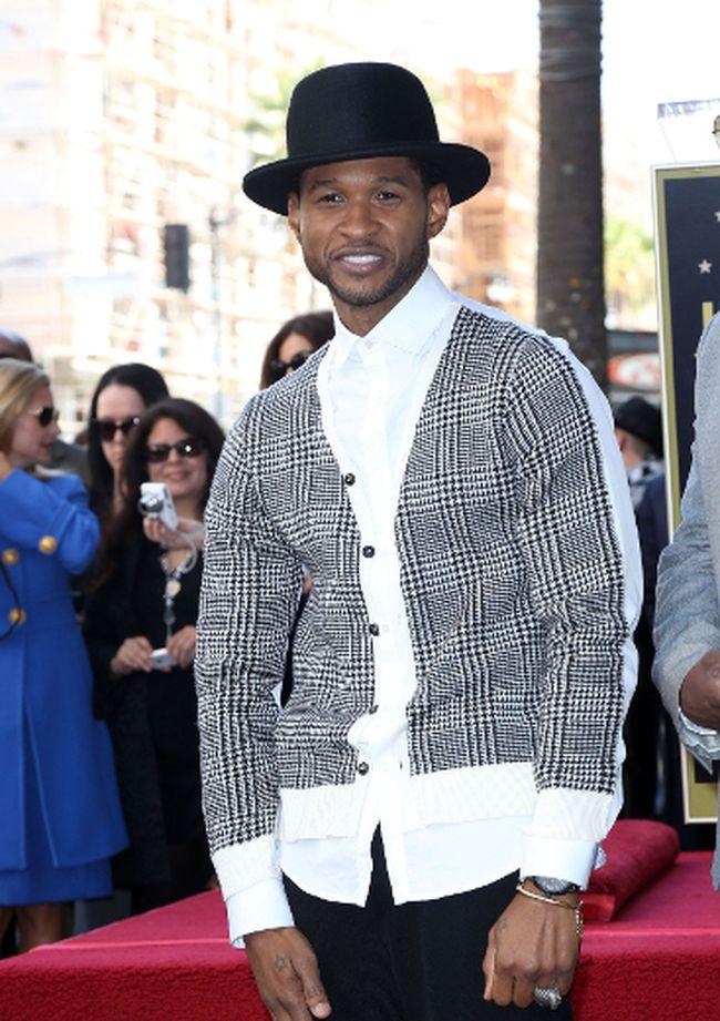 "Usher (<A HREF=""http://www.wenn.com"" TARGET=""newwindow"">WENN.COM</a>)"