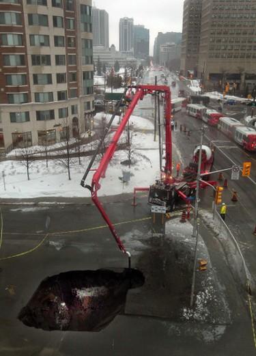Ottawa crews work on a sink hole in Waller Street  in Ottawa On. Friday Feb 21,  2014. Tony Caldwell/Ottawa Sun/QMI Agency