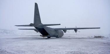 A Hercules plane prepares to depart at Kugaaruk, Nunavut and head back to Edmonton. (Pamela Roth/QMI Agency)