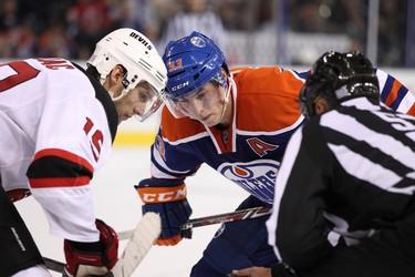 Edmonton Oilers Ryan Nugent-Hopkins (93) takes a faceoff against New Jersey Devils Travis Zajac (19) during the third period at Rexall Place in Edmonton, Alta., on Monday, Oct. 7, 2013. Ian Kucerak/Edmonton Sun/QMI Agency