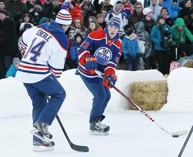 "Ryan Nugent-Hopkins looks to make a pass around Jordan Eberle during ""Project Shinny"" outdoor game at Hawrelak Park in Edmonton, Alberta on Sunday January 13, 2013 PERRY NELSON - EDMONTON SUN / QMI AGENCY"