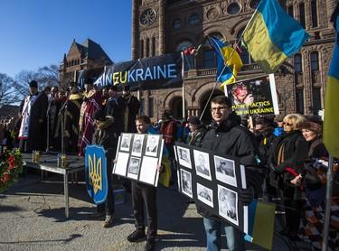 Members of the Ukrainian community rally in front Queen's Park in Toronto Sunday February 23, 2014. (Ernest Doroszuk/Toronto Sun)