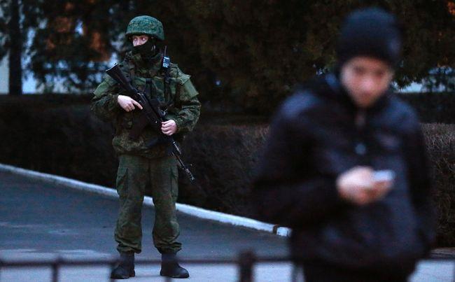 An armed man stands guard at the airport in Simferopol, Crimea February 28, 2014. (REUTERS/David Mdzinarishvili)