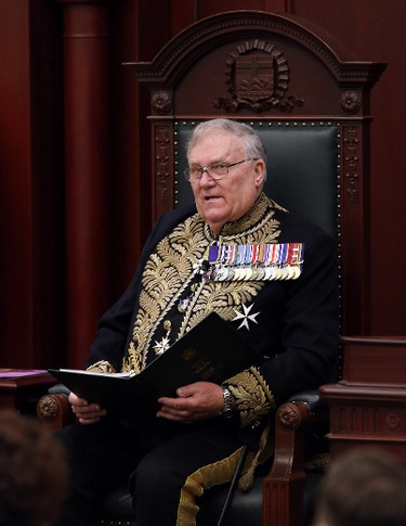 Lieutenant Governor Donald S. Ethell delivers the Speech from the Throne at the Alberta Legislature, in Edmonton Alta., on Monday March 3, 2014. David Bloom/Edmonton Sun/QMI Agency
