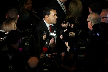 Alberta Liberal leader Raj Sherman speaks to the media following the Speech from the Throne at the Alberta Legislature, in Edmonton Alta., on Monday March 3, 2014. David Bloom/Edmonton Sun/QMI Agency