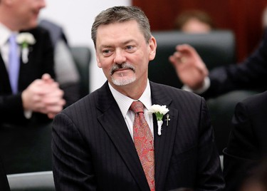 Minister of Finance Doug Horner arrives for the Speech from the Throne at the Alberta Legislature, in Edmonton Alta., on Monday March 3, 2014. David Bloom/Edmonton Sun/QMI Agency