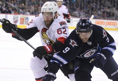 Winnipeg Jets forward Evander Kane (right) tries to get around Ottawa Senators defenceman Eric Gryba during NHL action at MTS Centre in Winnipeg, Man., on Sat., March 8, 2014. Kevin King/Winnipeg Sun/QMI Agency