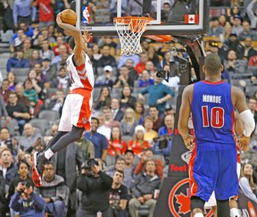 Raptors' DeMar DeRozan seals the deal with a monster jam against the Pistons on Wednesday night. (CRAIG ROBERTSON/Toronto Sun)