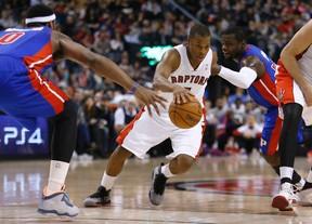 Raptors' Kyle Lowry weaves his way through the Detroit Pistons on March 12. (Craig Robertson/Toronto Sun/QMI Agency)