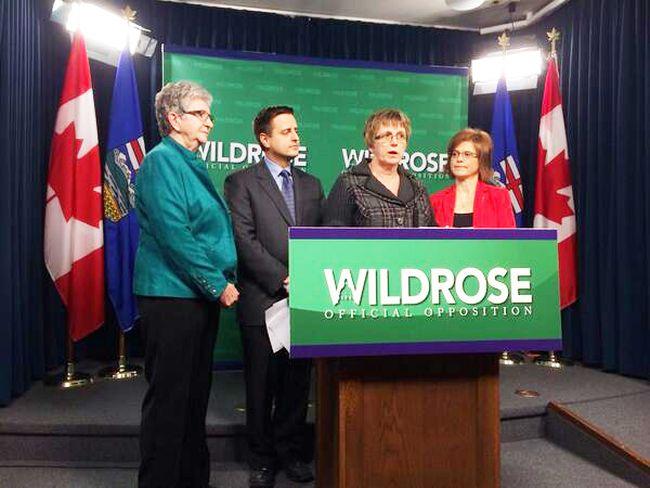 Local seniors and Wildrose MLAs Kerry Towle and Shayne Saskiw speak with the media Wednesday in Edmonton. MATT DYKSTRA/QMI AGENCY