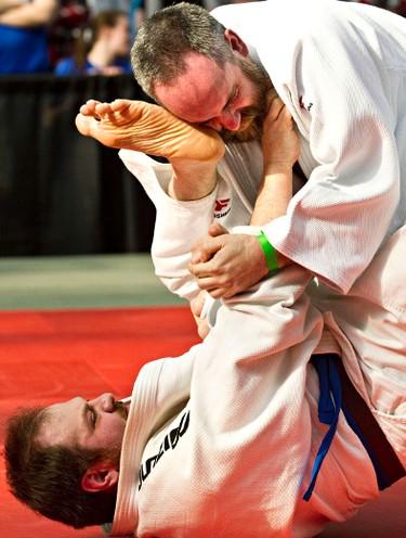 Bob Drury, top, takes on Andrew Langstaff, bottom, during the 2014 Edmonton International Judo Championships at West Edmonton Mall in Edmonton, Alta., on Saturday, March 15, 2014. Codie McLachlan/Edmonton Sun/QMI Agency