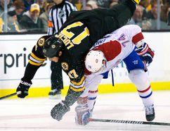 Montreal Canadiens defenceman Alexei Emelin hip checks Boston Bruins left wing Milan Lucic at TD Garden in Boston, March 24, 2014. (BOB DeCHIARA/USA Today)