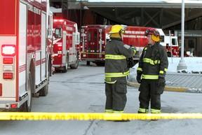 Winnipeg firefighters confer outside the Health Sciences Centre after a formaldehyde spill. (Brian Donogh/Winnipeg Sun)