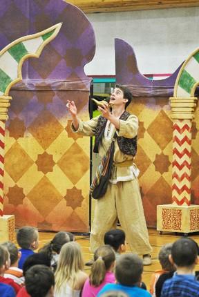 Aladdin (Adam Sanders)  finds the magic lamp hidden deep inside a cave during an Alberta Opera presentation at Pat Hardy Primary School. Barry Kerton | Whitecourt Star