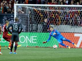 Real Salt Lake forward Alvaro Saborio scores past Toronto FC goalkeeper Julio Cesar on a penalty during Saturday night's game. (USA TODAY SPORTS)