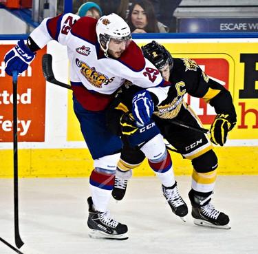 Edmonton's Mitch Moroz hits Brandon's Ryan Pulock during the second period of the Edmonton Oil Kings' WHL playoff hockey game against the Brandon Wheat Kings at Rexall Place in Edmonton, Alta., on Thursday, April 3, 2014. Codie McLachlan/Edmonton Sun/QMI Agency